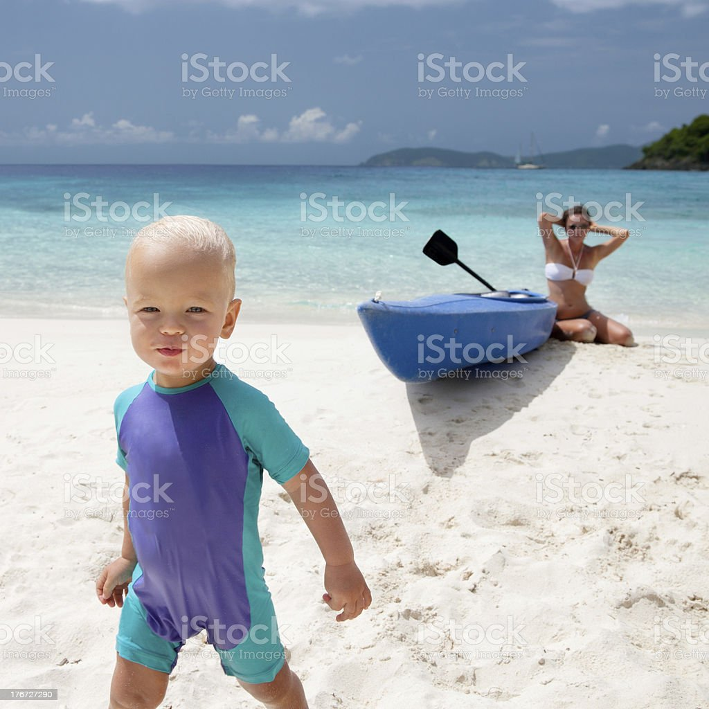 blond haired baby boy walking at a Caribbean beach royalty-free stock photo