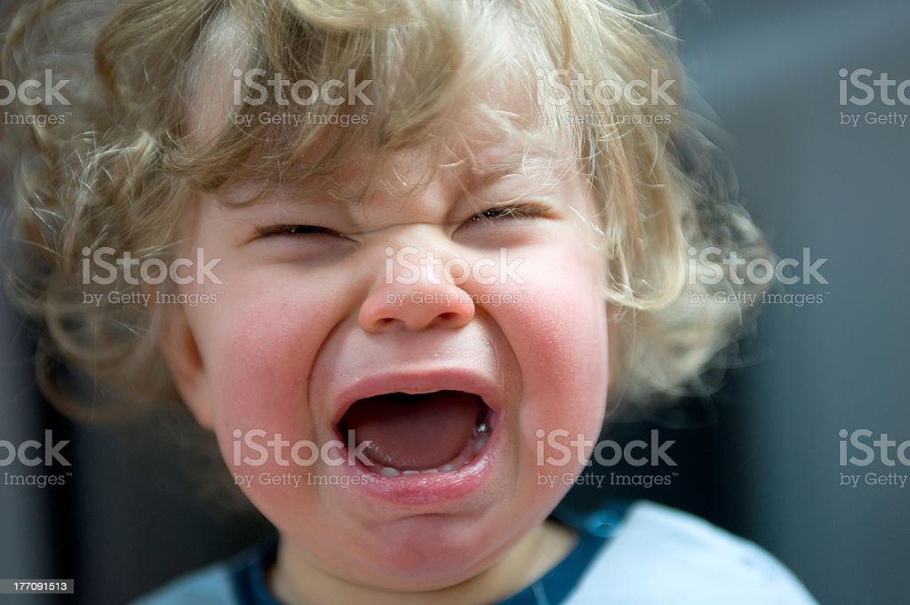 A blond haired toddler having a tantrum stock photo