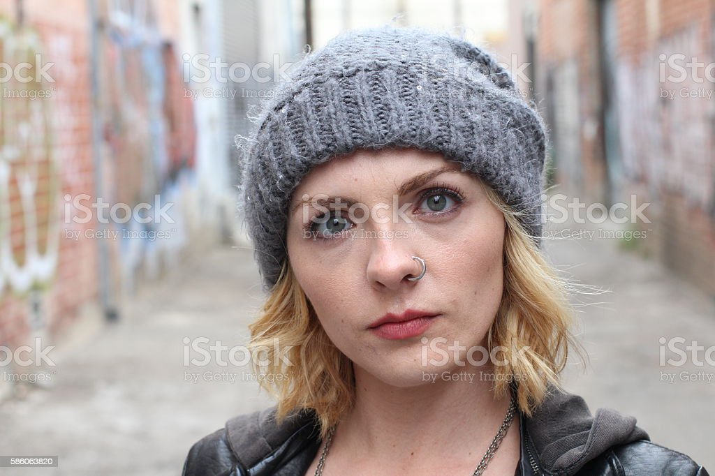 Blond hipster girl with a nose ring stock photo