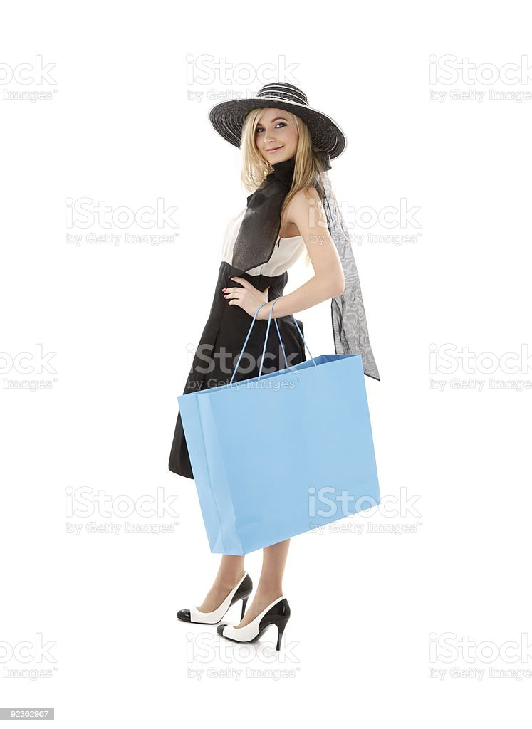 blond in retro hat with blue shopping bag #3 royalty-free stock photo