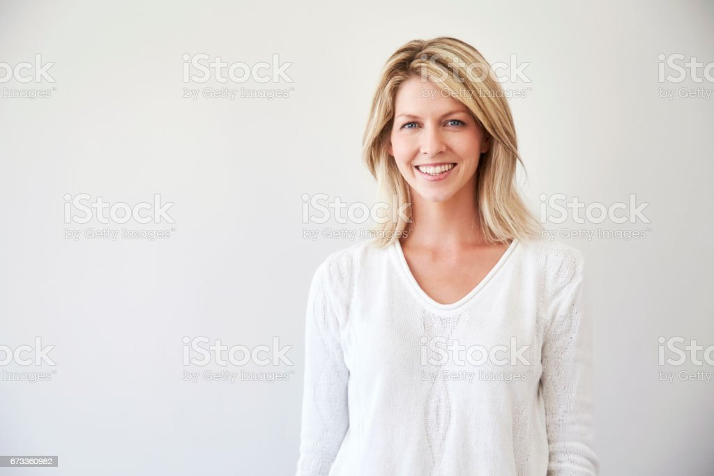 Blond in white stock photo