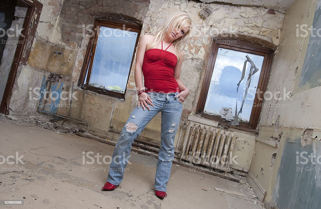 Blond model posing in abandoned factory royalty-free stock photo