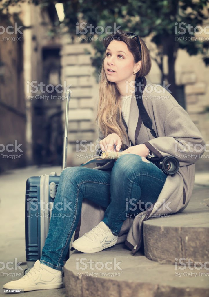Blond ordinary girl holding brochure royalty-free stock photo