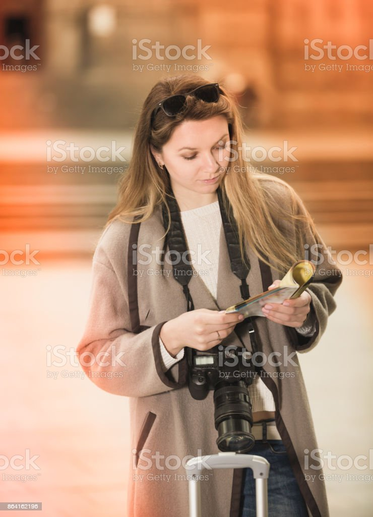 Blond smiling woman holding brochure in hands royalty-free stock photo