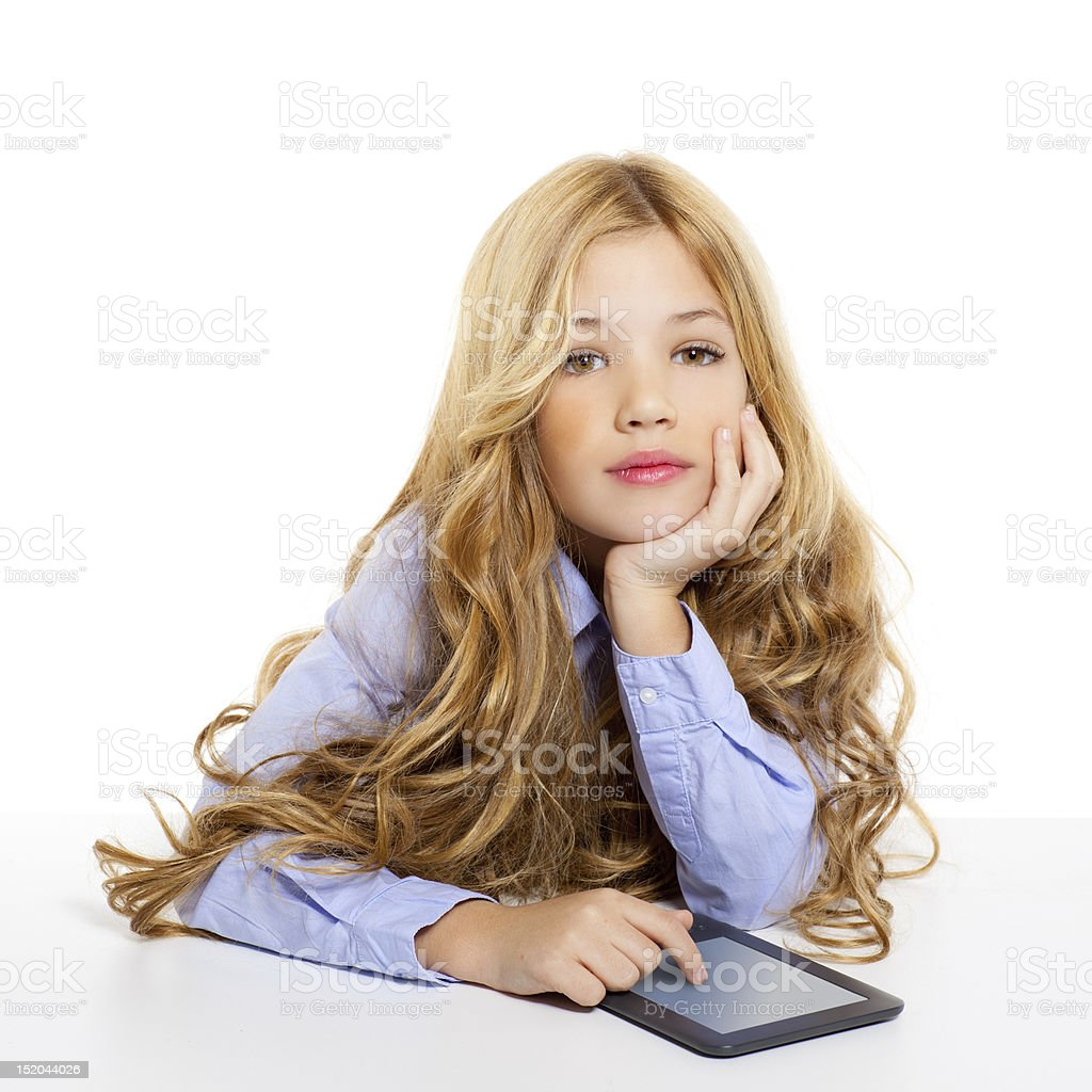 blond student kid with ebook tablet pc portrait in desk royalty-free stock photo