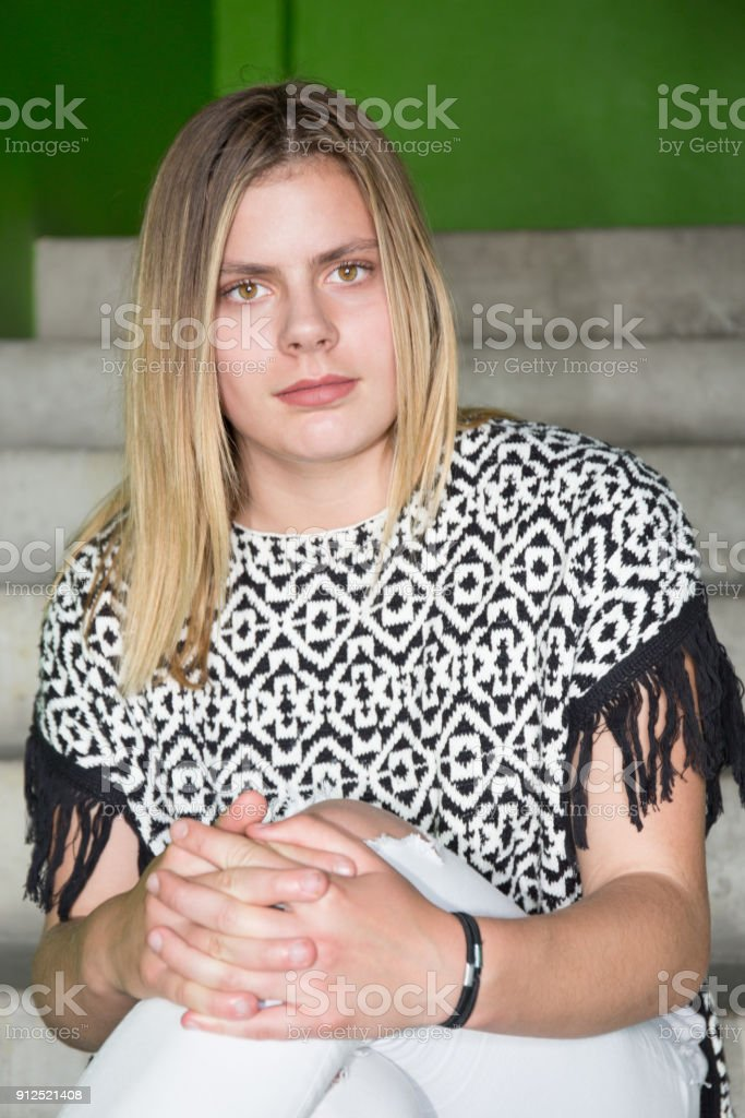 Blond Teenager Girl Sit On Stairs In Urban City Royalty Free Stock Photo