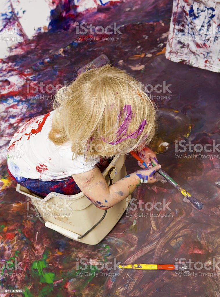Blond Toddler Girl in a Bucket with Two Paintbrushes royalty-free stock photo