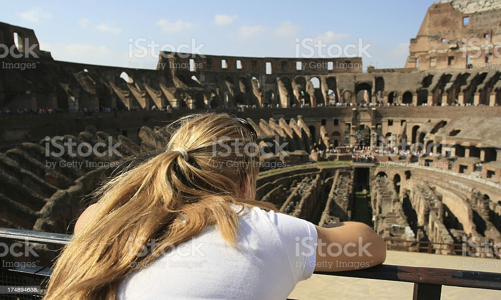 Blond tourist in Coliseum, Rome Italy royalty-free stock photo