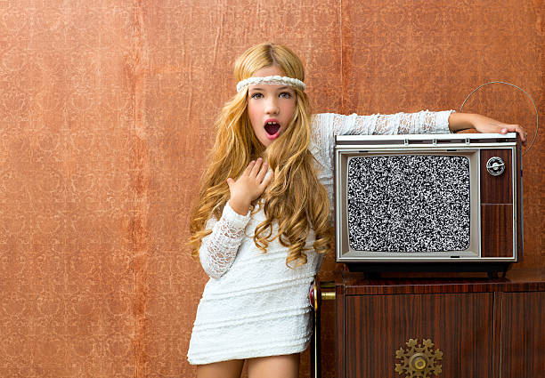blond vintage 70s kid girl with retro wood tv surprised - diadem stock pictures, royalty-free photos & images