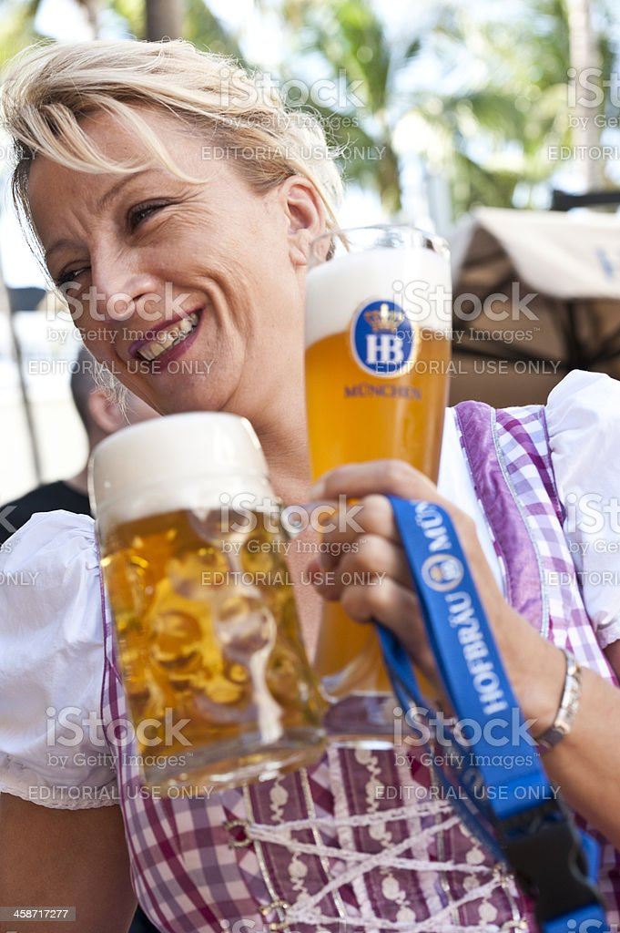 Blond Waitress Serving German Beer royalty-free stock photo