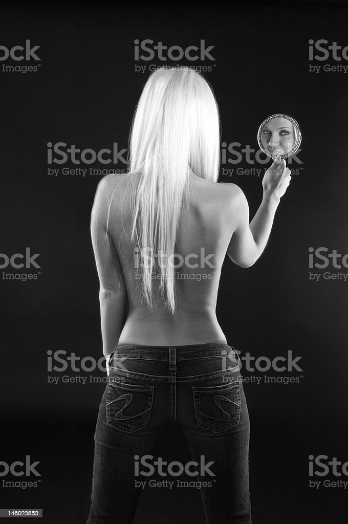 Blond with mirror in jeans B&W stock photo