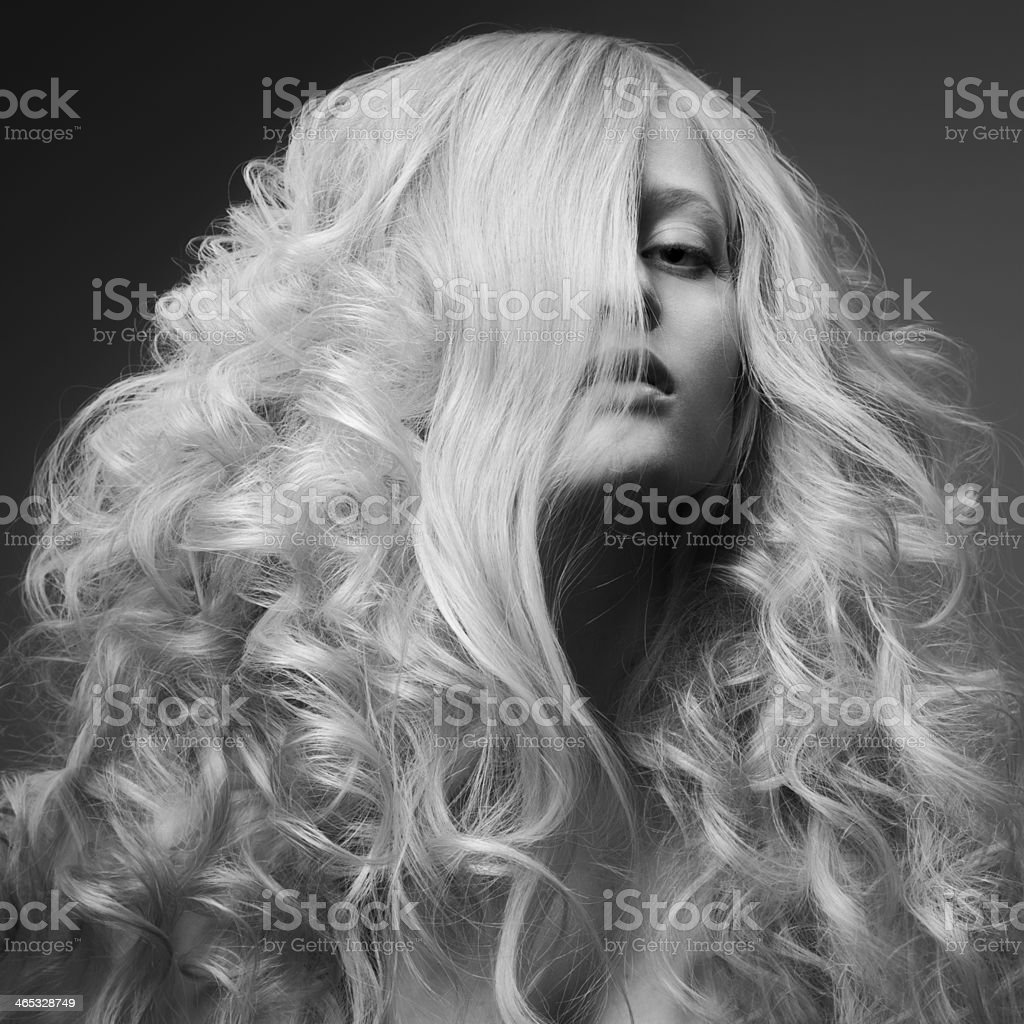 Blond Woman. Curly Long Hair. BW Fashion Image stock photo
