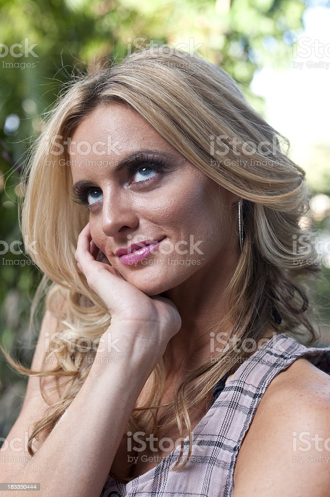 Blond woman day dreaming royalty-free stock photo
