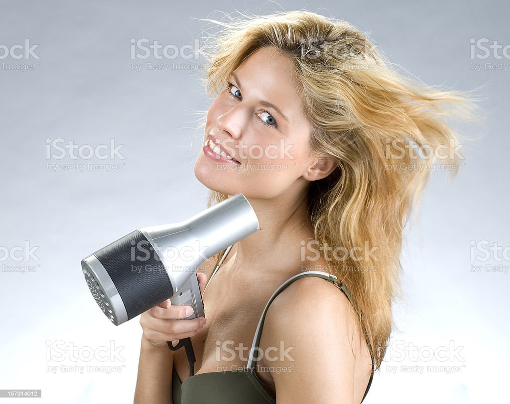 blond woman drying hair royalty-free stock photo