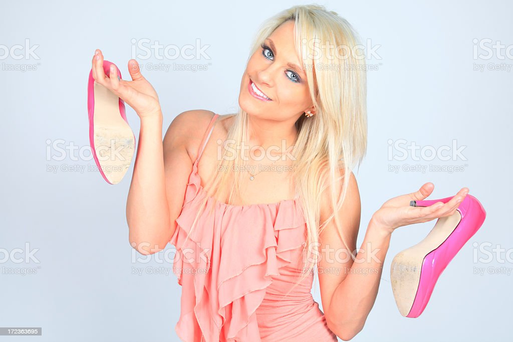 Blond Woman Holding High Heel Shoes royalty-free stock photo
