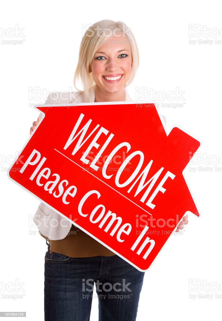 Blond Woman Holding Real Estate Sign royalty-free stock photo