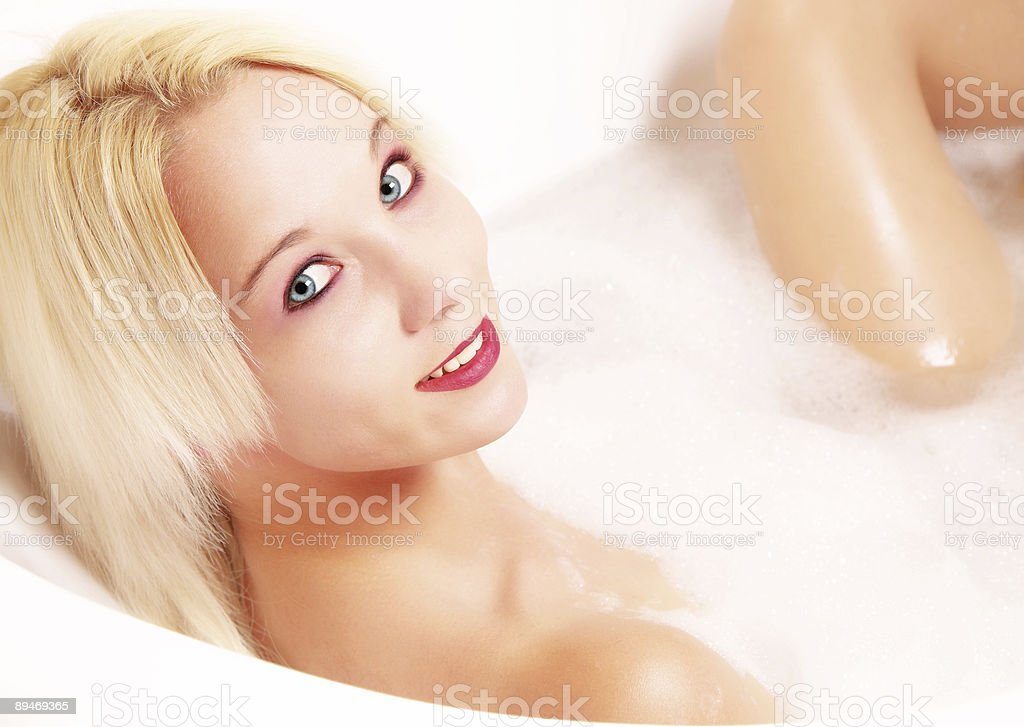 Blond woman in bath with smile royalty-free stock photo