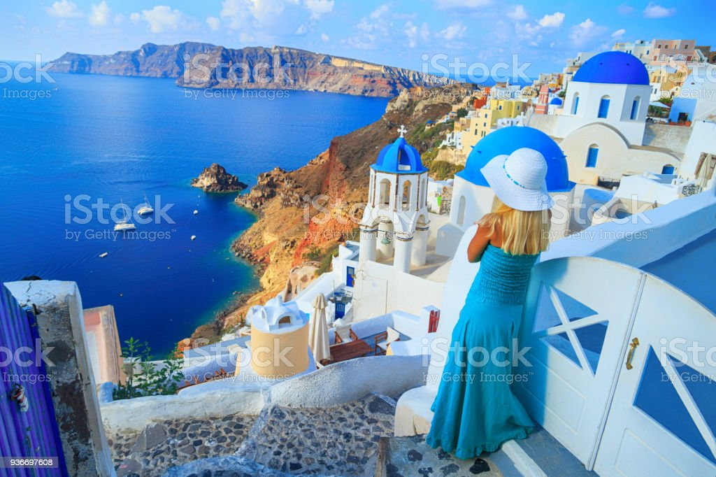 Blond woman looking at view in Santorini stock photo