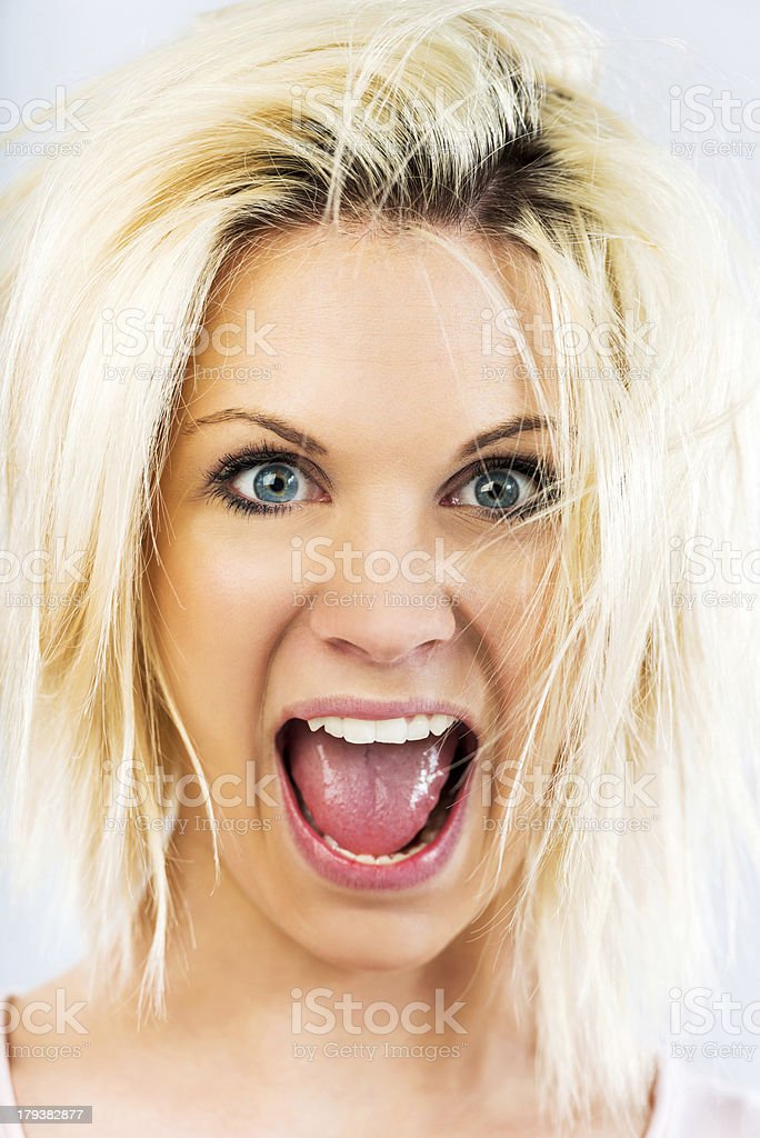 Blond woman making a face. royalty-free stock photo