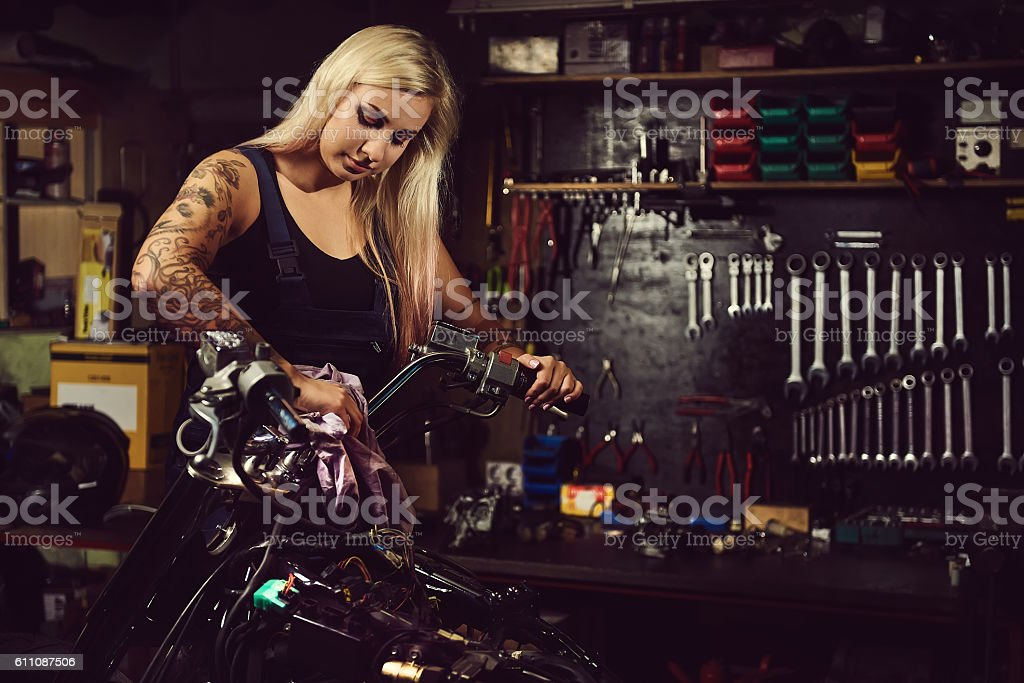Blond woman mechanic stock photo