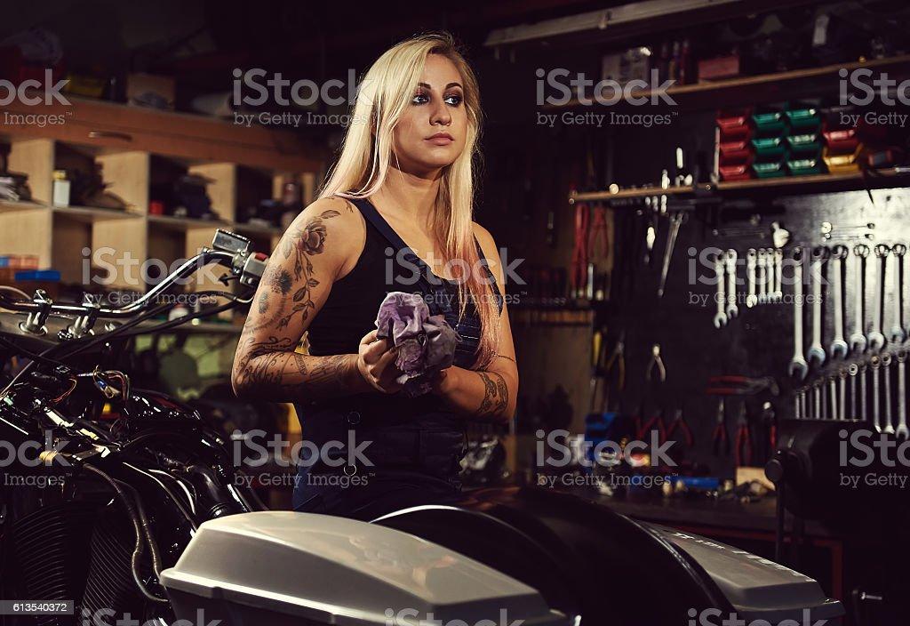 Blond woman mechanic stock photo