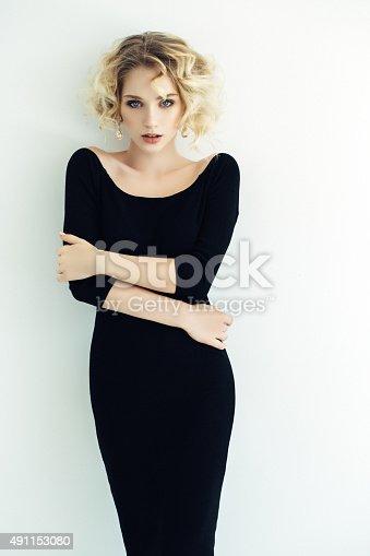 Blond Woman on light background
