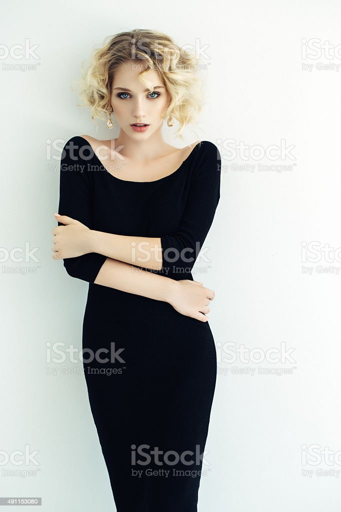 Blond woman on light background stock photo