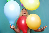 istock Blond woman playing with balloons 491873845