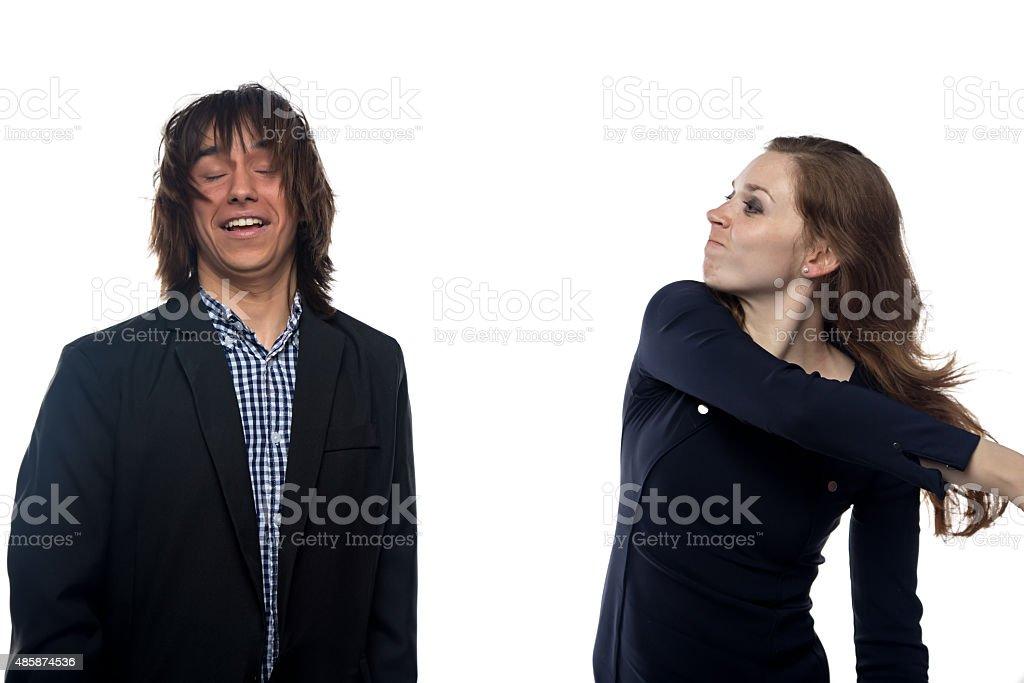 Blond woman slaping man stock photo