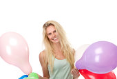 istock Blond woman smiling with balloons 490200607