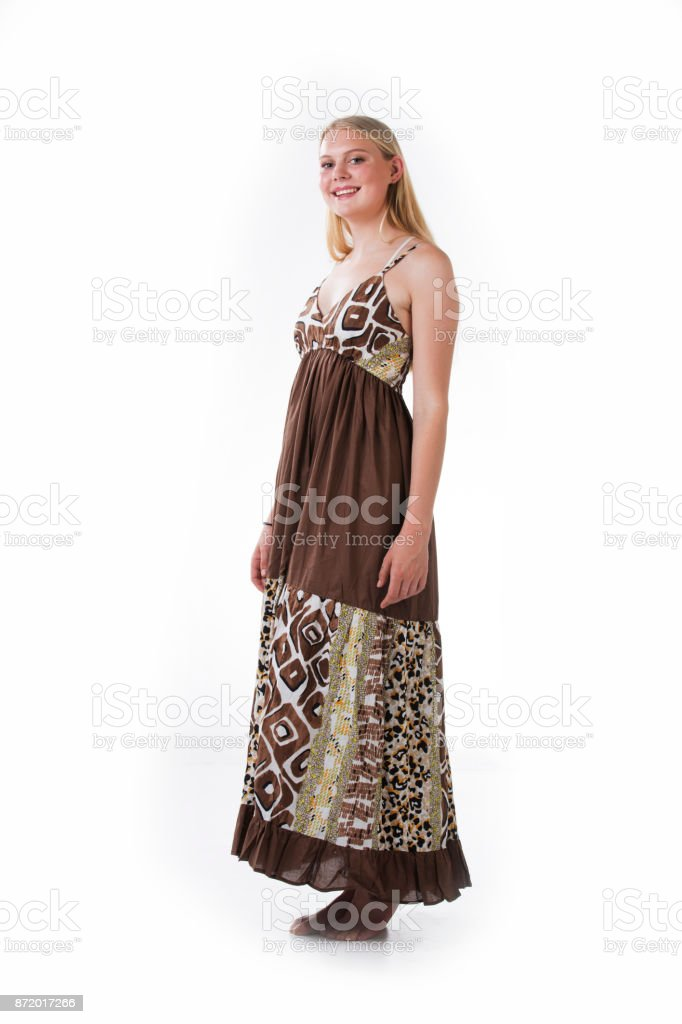 Blond woman wearing a long brown dress with white background stock photo