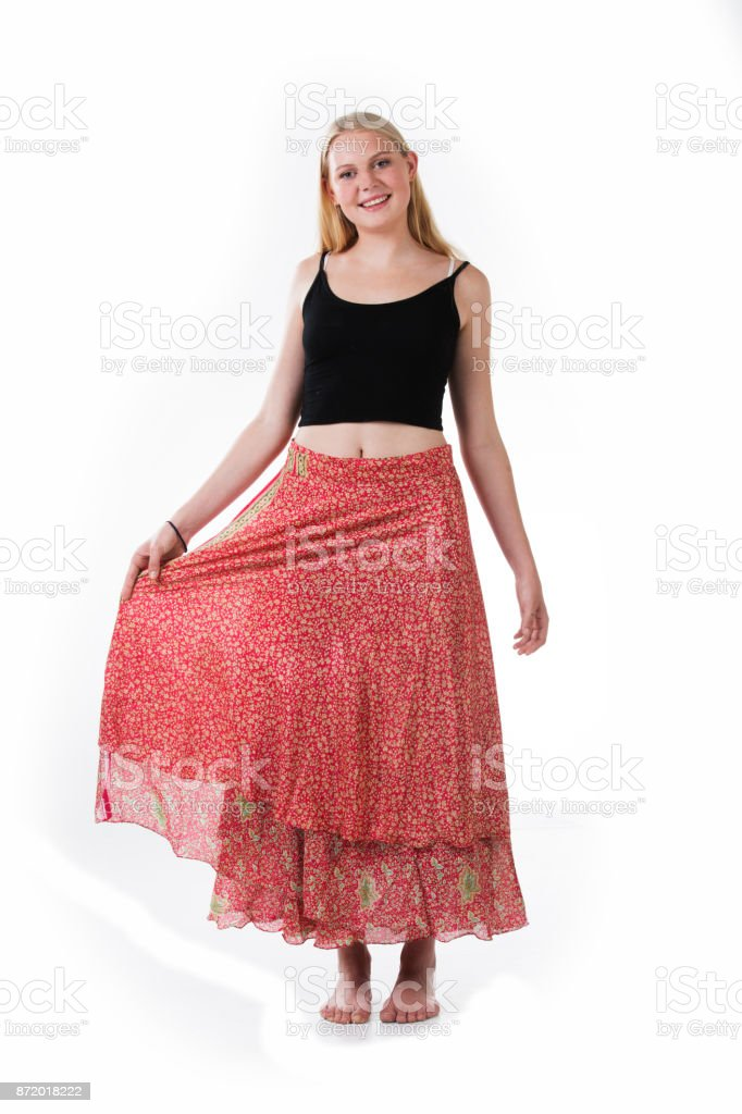 Blond woman wearing a pink sarong with white background stock photo