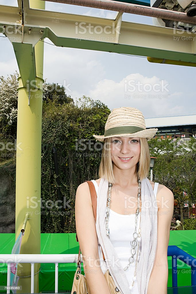 Blond woman wearing a straw hat royalty-free 스톡 사진