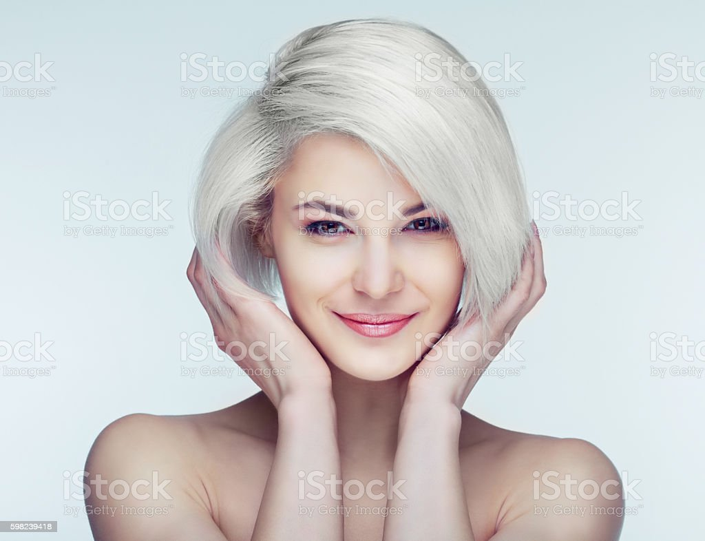 blond woman with brown eyes stock photo