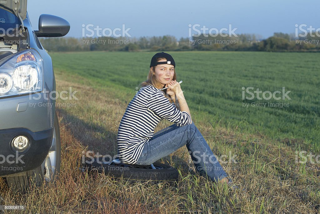Blond Woman With Her Broken Car stock photo