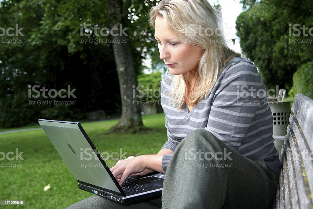 blond woman with laptop royalty-free stock photo