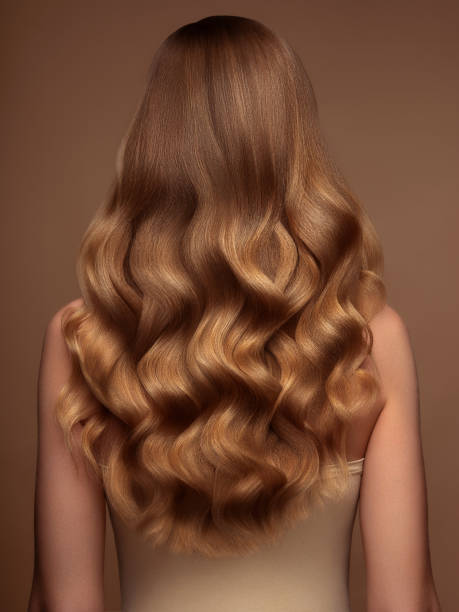 Blond woman with long and shiny hair Blond woman with long and shiny hair curly hair stock pictures, royalty-free photos & images
