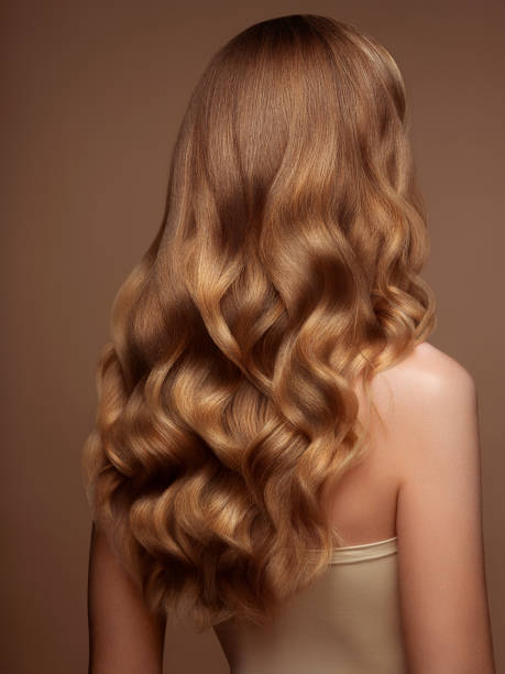 Blond woman with long and shiny hair stock photo