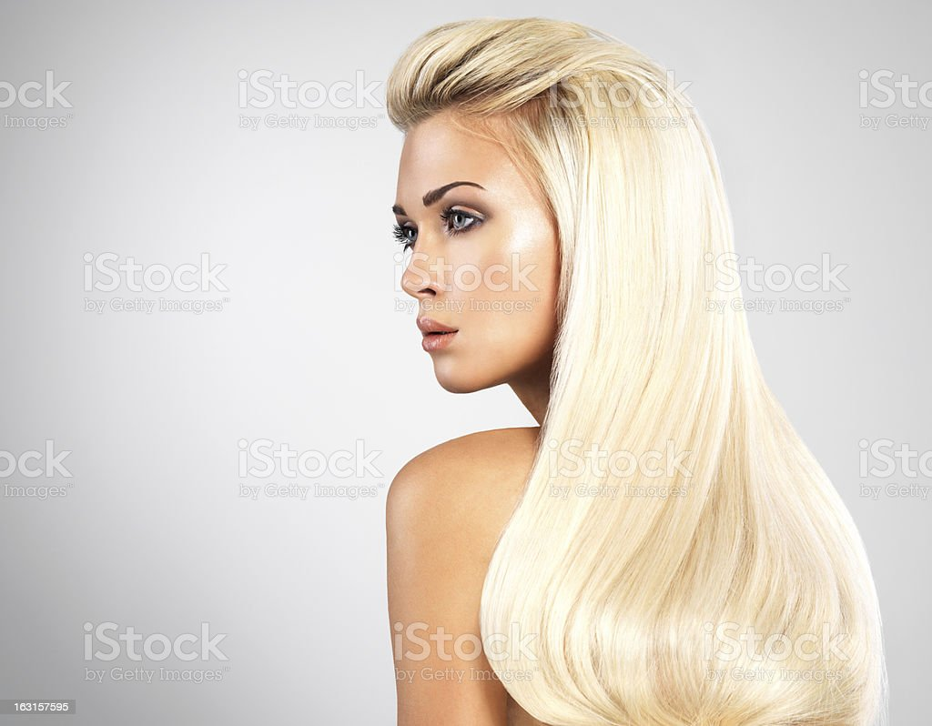 Blond woman with long straight hairs stock photo