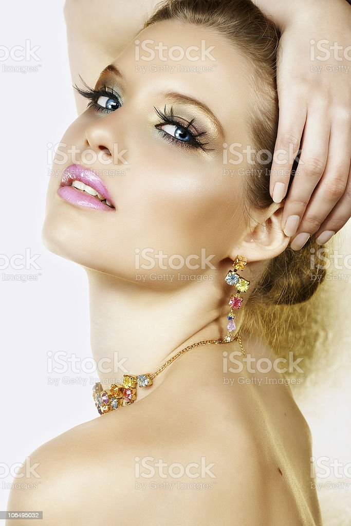 Blond woman with necklace and smile royalty-free stock photo