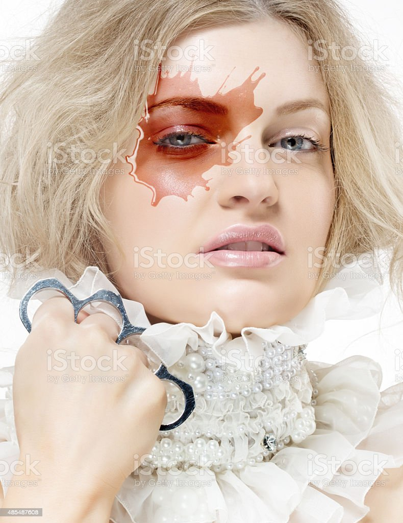 blond woman with pearls jewellery and knuckle duster stock photo