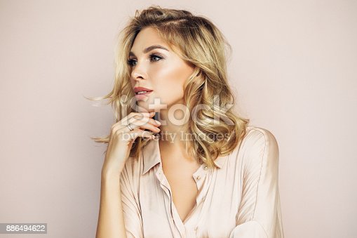 istock Blond woman with perfect skin 886494622