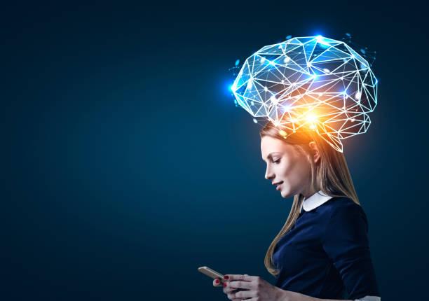 blond woman with phone and brain hologram - business woman hologram imagens e fotografias de stock