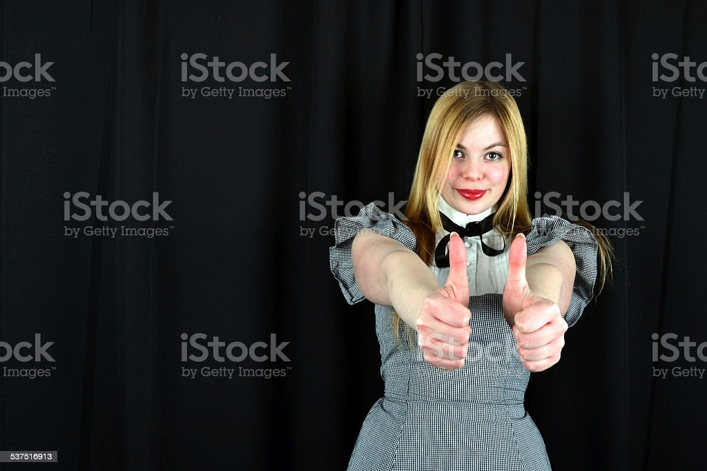 Blond woman with thumbs up stock photo