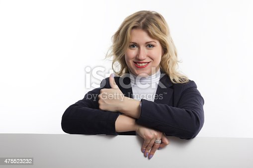 1048561866 istock photo Blond women holds white business card on white background 475523232