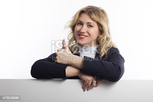 istock Blond women holds white business card on white background 475526080