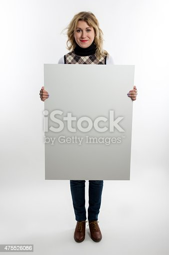 istock Blond women holds white business card on white background 475526086
