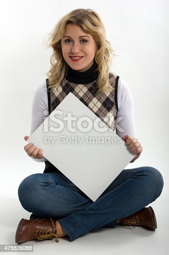 1048561866 istock photo Blond women holds white business card on white background 475526088