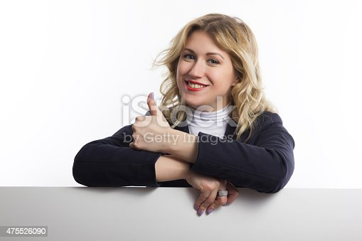istock Blond women holds white business card on white background 475526090