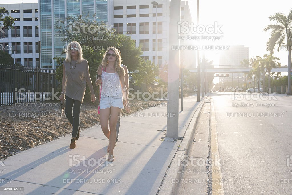 Blond Women Walking Against the Setting Sun royalty-free stock photo